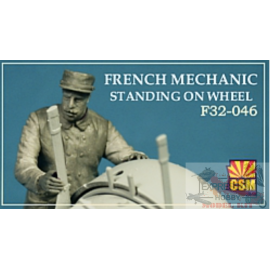 FRENCH MECHANIC STANDING ON...